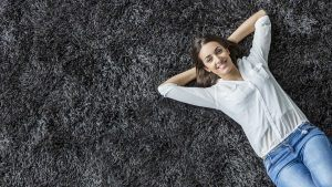 Woman Laying on Frieze Carpet